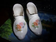 (2) vintage of white high heel ceramic shoes with colored daisies and gold trim
