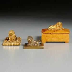 GROUP OF (3) MINIATURE GILT BRONZE RECUMBENT LIONS