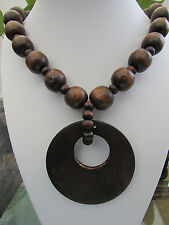 """A CHUNKY DARK-BROWN WOODEN BEAD STRETCH NECKLACE. 20"""" + EARRINGS & BRACELET.   1"""