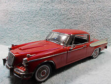 1/18 1957 STUDEBAKER GOLDEN HAWK IN REDWHITE STRIPE BY MOTOR CITY NO BOX.