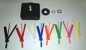 Quartz clock movement (mechanism). With coloured plastic hands and fixings