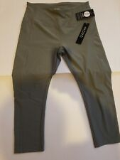 Women's yoga pants with pockets. Yogo brand New olive color. 88% Polyester Large