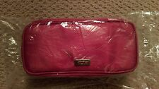 New Un-Opened Red TUMI travel accessory pouch - new & sealed accessories inside