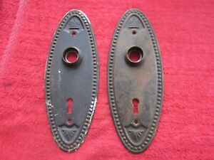 2 MATCHING ANTIQUE OVAL DOOR KNOB BACKPLATES, CROWN & PLUME
