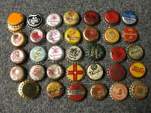 Group of old beer and soda bottle caps
