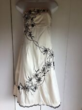 Ladies dress uk 12 By Jane Norman Colour Cream with black flower Design