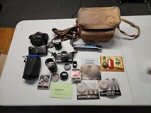 Olympus OM-2 35mm SLR Film Camera with 50 mm plus Cosina 200 mm lens