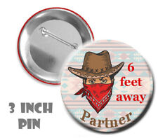 Social distance button with cowboy graphic on a 3 inch pin