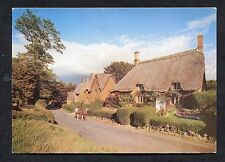 View of People Walking Through Great Tew, Oxfordshire. Dated 1991.