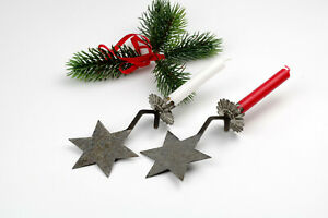 2 Antique hanging candlestick star on a Christmas tree,weights on a tree branch.