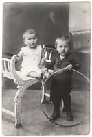 Antique child photo 1910's little boys w toys home interior children RPPC *7052F