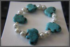 Gemstone Howlight Turquoise Elephants and 10mm Glass Beads Bracelet
