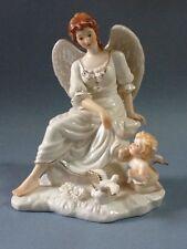 A Beautiful Porcelain Angel w/ Cherub Figurine
