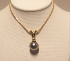 Brand new grey Tahitian Pearl Pendant set in 14k solid yellow gold.