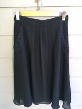 Womens Black Skirt Size 12 Polyester Lined Side Pockets Front Pleats TUGS