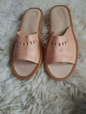 Women's slippers made from natural leather.