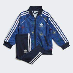 adidas Originals infant navy/multi Superstar tracksuit. Ages 0-4 years.