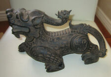 Old Asian ceramic figurine of a dragon ornately carved