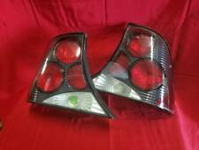 APC 00-04 FORD FOCUS CARBON FIBER EURO 4 DR TAIL LIGHTS TAILLIGHTS PAIR NEW RARE