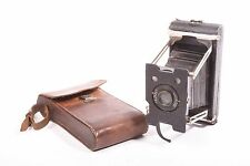 Vest Pocket N°1 folding camera by Ansco with f/8 lens and case.