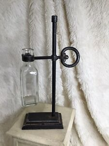 Clear Decorative Bottle With Cast Iron Holder on Stand