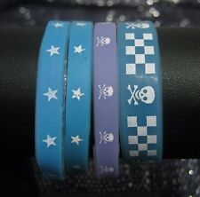 4x Great child's wirstbands in blue and lilac skull and cross bones