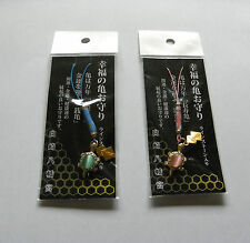 A couple of Turtle Amulets for fortune -- green and red carapaces / Kame Omamori
