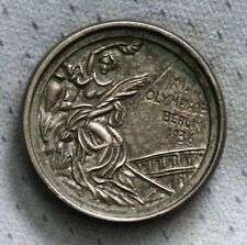 Olympic souvenir two-sided silver tone 1936 medal themed paperweight medallion