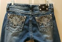Miss me easy boot denim jeans distressed. Size 28X31 Rise 8  Waist measures 16.5