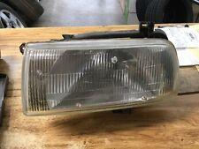 93-98 jetta headlight left OEM used