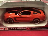Maisto 2012 Ford Mustang Boss 302  1/24 scale ,new in box, orange exterior