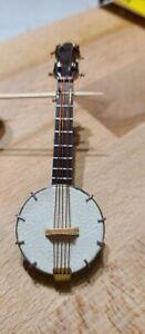 Lot #M1- Realistic Mini Instrument Magnets Banjo & Trombone by Broadway Gifts