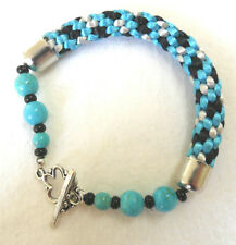 "Kumihimo 7"" bracelet 10mm wide, blue magnesite beads"
