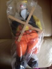 New wooden string puppets,with blue eyes, red nose,yellow, orange, black clothes