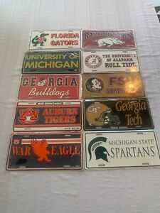 NCAA Assorted Teams Metal License Plate Brand New