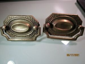 2 Antique drawer pulls stamped brass