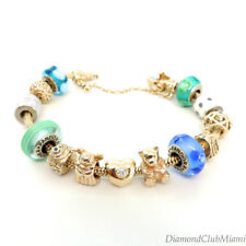 Pandora  14kt  Yellow Gold Bracelet 14kt  Charm and murano stones 100.3 grams