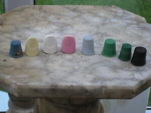8 vintage colourful plastic thimbles