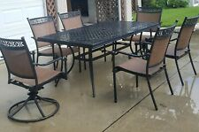 Hampton Bay Patio table with 2 swivel/tilt and 4 other chairs.
