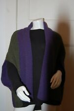 Hand knitted two tone shrug cardigan in Purple and green..  Made In Victoria.