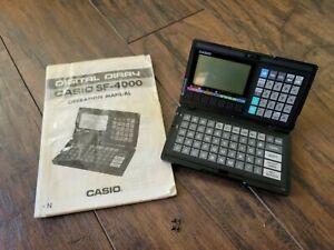 1980's Vintage Rare Casio SF-4000 Digital Diary Organizer, manual & travel guide