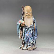 Statuette d'un dignitaire chinois en céramique