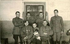 SEVEN SOLDIERS WITH A DOG POSING FOR THE CAMERA & VINTAGE REAL PHOTO POSTCARD