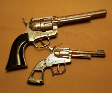 Vintage Diamond H and Hubley cap toy guns