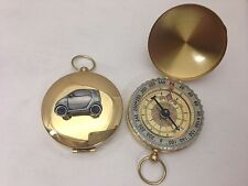 Smart Car ref240 Pewter Effect car emblem on a Golden Compass