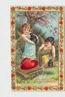 PPC POSTCARD VALENTINE CUPID CHERUBS WEIGHING HEART ON SCALE GOLD EMBOSSED