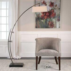 CALOGERO MID CENTURY INDUSTRIAL INSPIRED ADJUSTABLE CURVED FLOOR LAMP UTTERMOST