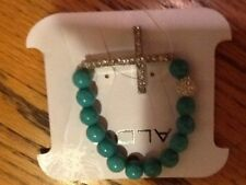 ALDO STRECH BRACELET TURQUOISE with  CROSS Brand new with tag GREAT present