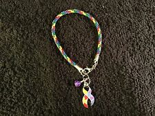 (1 ) Autism Awareness Bracelet ( multi colored Paracord) + ribbon