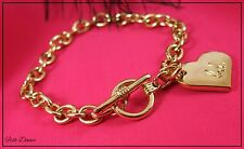 BOMBAY DUCK. GOLD T-BAR FASTENING CHARM BRACELET WITH BD HEART CHARM (23)